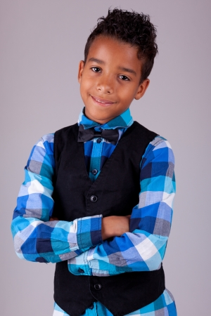 Portrait of a cute african american little boy with folded arms, isolated on white background Stock Photo - 17055168