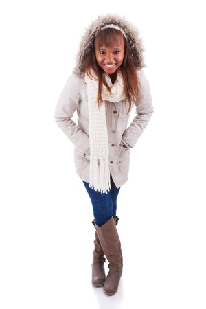 Young african american woman wearing winter clothes, isolated on white background photo