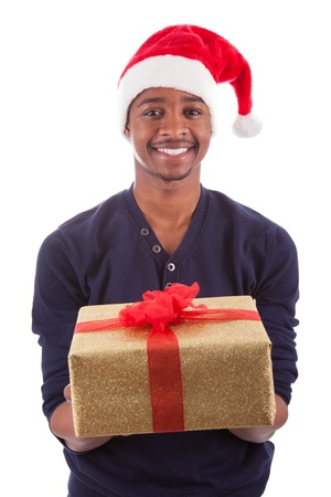 Young African American man wearing a santa hat offering a  gift , isolated on white background photo