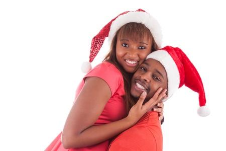 american african: Coppia giovane africano americano che porta il cappello della Santa, isolato su sfondo bianco