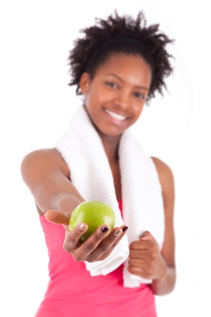 afro caribbean: Young african american woman holding  an apple over white background