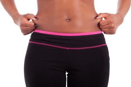 ni�a comiendo: Vientre de una joven sexy mujer de raza negra, aislados en fondo blanco
