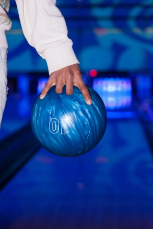 African American hand holding a bowling ball photo