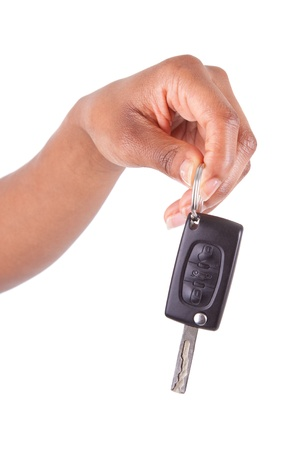 African American woman Hand Holding New Car Key, isolated on white background photo