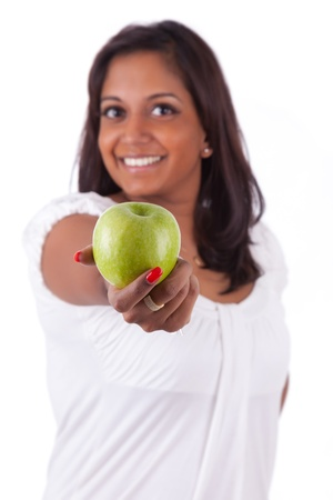 Young happy indian woman holding an apple, isolated on white background