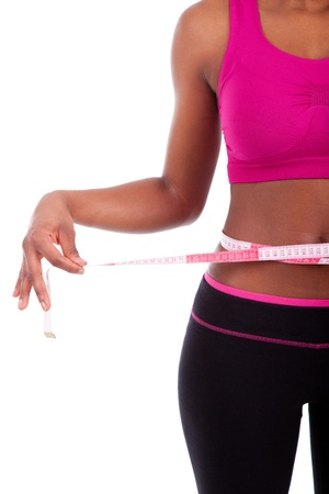 African American Fitness woman measuring her belly, isolated on white background photo