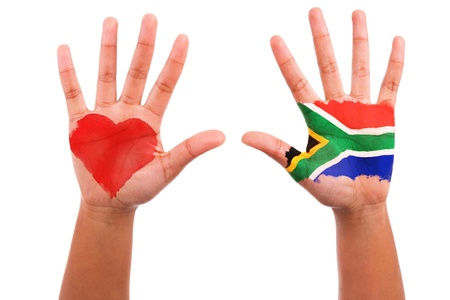south african: African hands with a painted heart and south african flag, i love south africa concept, isolated on white background
