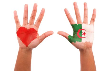 algerian flag: African hands with a painted heart and algerian flag, i love algeria concept, isolated on white background Stock Photo