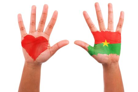 burkina faso: African hands with a painted heart and burkinabe flag, i love burkina faso concept, isolated on white background