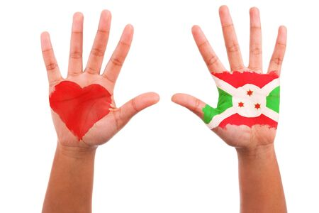 African hands with a painted heart and burundian flag, i love burundi concept, isolated on white background photo