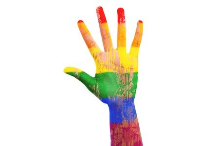 bandera gay: Mano africano con una bandera pintada lgbt, aislados en fondo blanco Foto de archivo