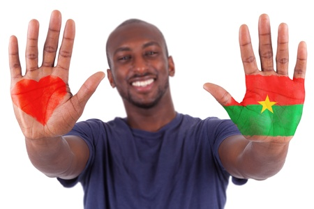 burkina faso: African man hands with a painted heart and burkinabe flag, i love burkina faso concept, isolated on white background Stock Photo