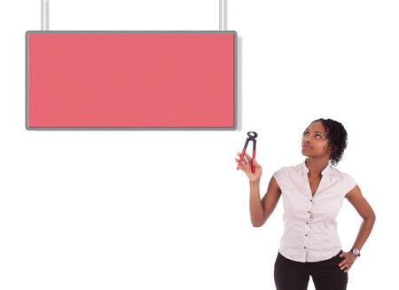 Young african american woman looking to unhook a empty board, isolated on white background Stock Photo - 18035391