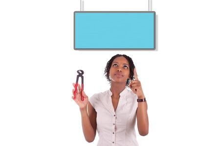 Young african american woman looking to unhook a empty board, isolated on white background Stock Photo - 18035395