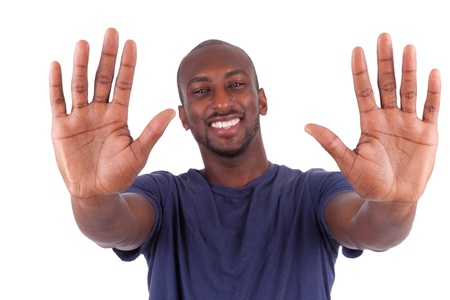 Young African American man his hands palm, isolated on white background photo