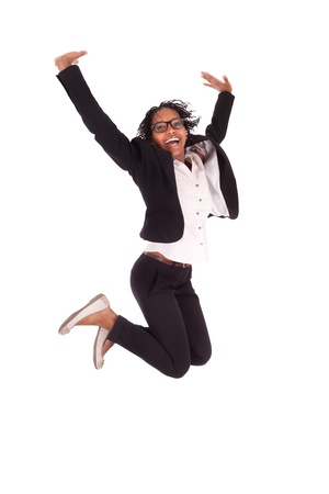 brazilian caribbean: Young african american business woman jumping, success concept, isolated on white background Stock Photo
