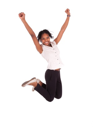 african american businesswoman: Young african american business woman jumping, success concept, isolated on white background Stock Photo