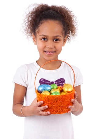 south asians: African Asian girl holding chocolate ester egg, isolated on white background Stock Photo