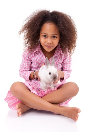 African Asian girl holding a rabbit, isolated on white background photo