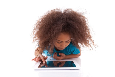 curly hair child: Little african asian girl using a tablet  pc, isolated on white background