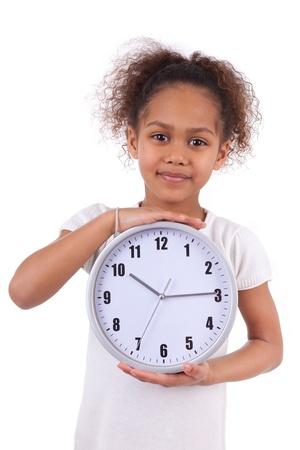 Little african asian girl holding a  clock, isolated on white background photo