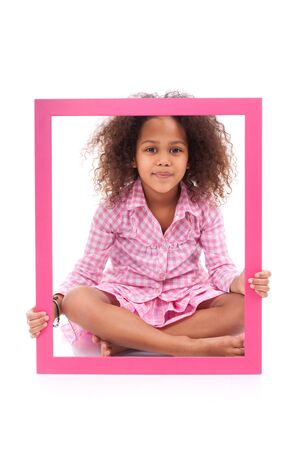 Portrait of a cute little african american girl, holding a picture frame,isolated on white background photo