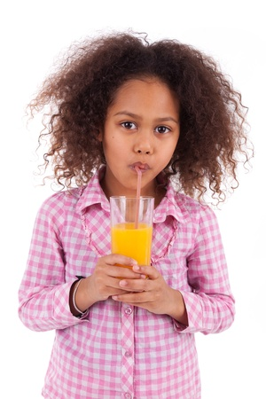 Little african asian girl drinking orange juice,isolated on white background photo