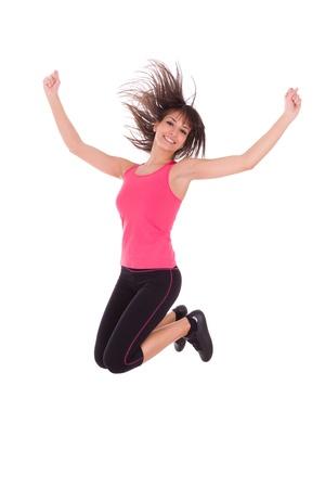persona saltando: La p�rdida de peso aptitud mujer saltando de alegr�a, aisladas sobre fondo blanco Foto de archivo
