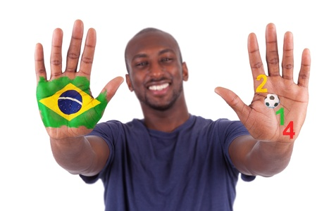Brazilian man hands with a painted heart and brazilian flag, i love brazil concept, isolated on white background concept, isolated on white background photo