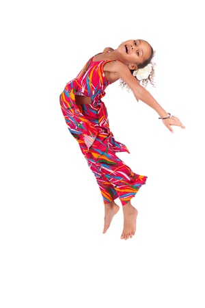 thai dancing: Portrait of cute Young African Asian  girl jumping, over gray background