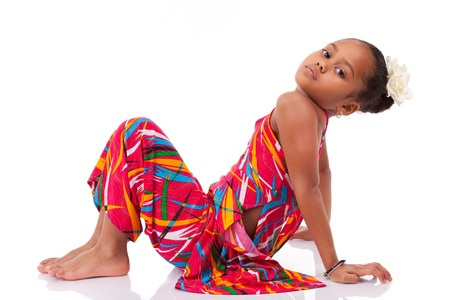 asian afro: Portrait of a cute young African Asian girl seated on the floor
