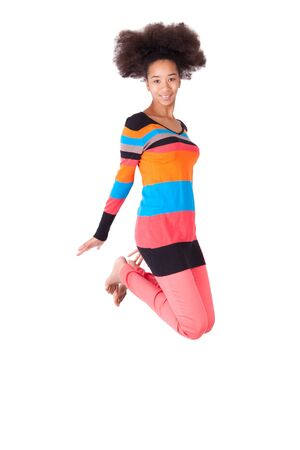 Black African American teenage girl with a afro haircut jumping of joy, isolated on white background photo