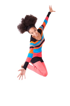 afro caribbean: Black African American teenage girl with a afro haircut jumping of joy, isolated on white background Stock Photo