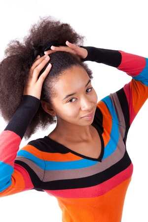 Black African American teenage girl holding her afro hair, isolated on white background