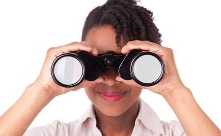 south african: Young black   african american business woman using binoculars, isolated on white background