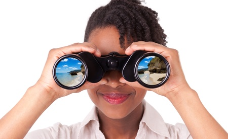 Young black   african american business woman using binoculars looking for vacations, isolated on white background Stock Photo - 18964675