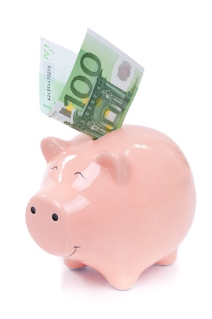 Smiling  Piggy bank with euro bills isolated on white background photo