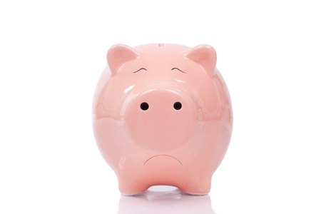 debt goals: Sad piggy bank isolated on white background
