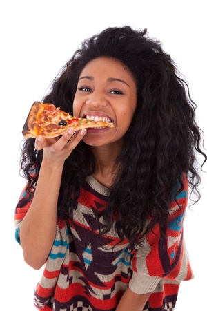 south african: Young black african american teenage girl eating a slice of pizza, isolated on white background - african people