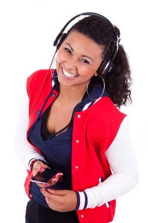 american music: Young black  African American teenage girl  listening to music, isolated on white background - African people