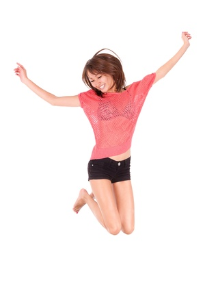 Young beautiful asian woman jumping of joy, isolated on white background - Asian people photo