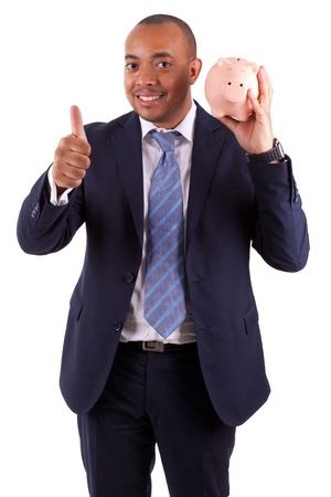 African American business man holding a piggy bank making thumbs up, isolated on white background - African people photo