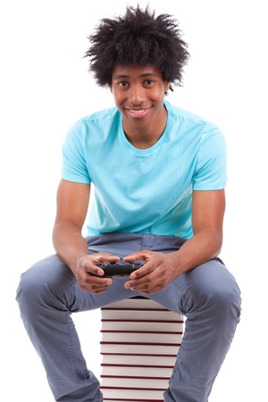 Young black teenage men playing video games, isolated on white background - African people photo