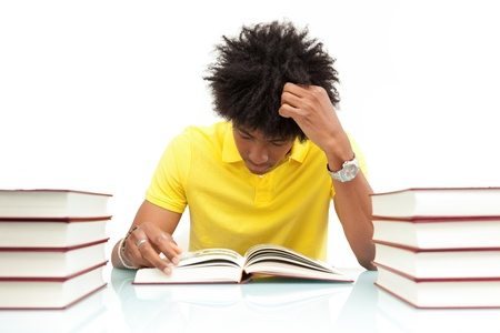 Young african american student reading books, over white background - African people photo