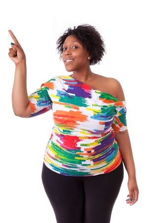 pointing up: Young black woman pointing up, isolated on white background - African people