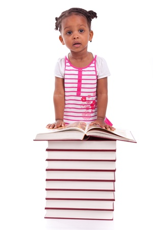 Cute black african american little girl reading a book, isolated on white background - African people - Children Stock Photo - 19665273