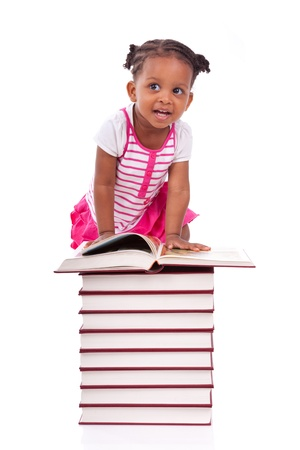 Cute black african american little girl reading a book, isolated on white background - African people - Children Stock Photo - 19665264
