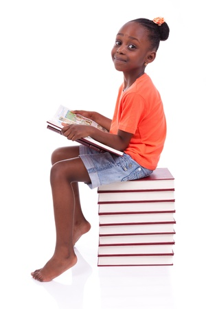 Cute black african american little girl reading a book, isolated on white background - African people - Children Stock Photo - 19665317