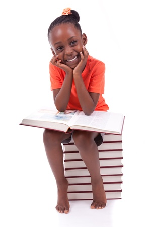 africa american: Cute black african american little girl reading a book, isolated on white background - African people - Children