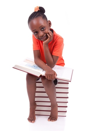 Cute black african american little girl reading a book, isolated on white background - African people - Children Stock Photo - 19665276